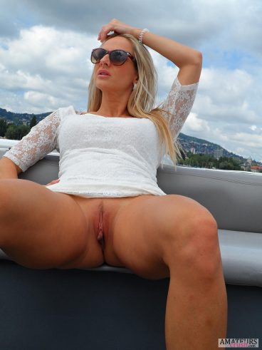 No panties MILF showing her juicy pussy outdoor on a boat