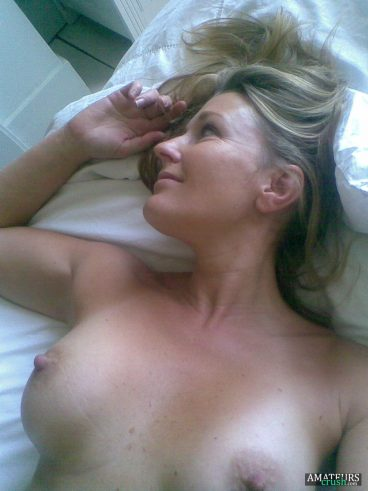 Sexy MILF pics with her puffy nipples on bed