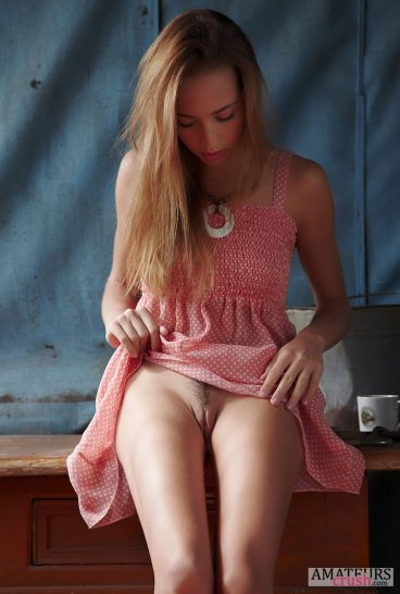 Sexy teen flashing her pussy upskirt while sitting on counter