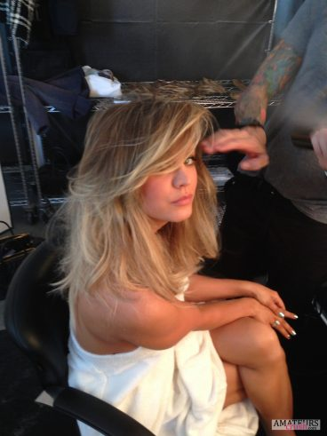 Kaley Cuoco getting her hair done by a stylish pic