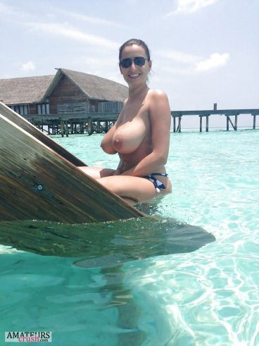 Topless MILF pics on vacation with blue sea and sky