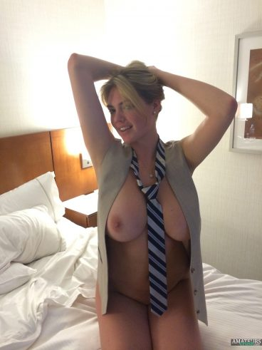 Kate Upton nudes showing her big tits and wearing a tie on bed
