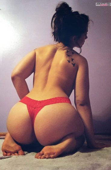 Big beautiful ass of amateur Missentropyy in red thong sitting on her knees