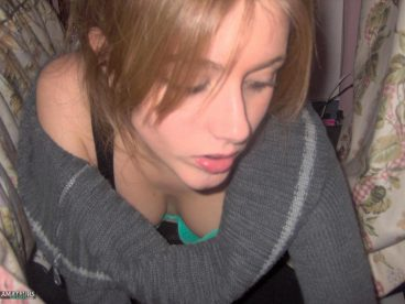 Down blouse teen tits showing her cleavage underneath her sweater