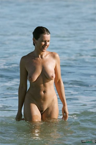 Beach voyeur of hot naked wife in the waters