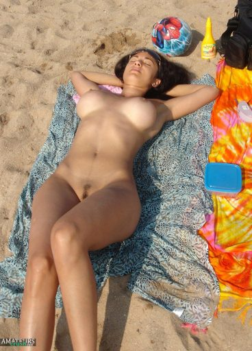 Beautiful nude beach voyeur of big boobs naked wife and her trimmed pussy tanning