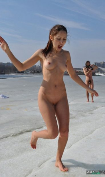 Nudist girlfriend on naked beach jumping out waters
