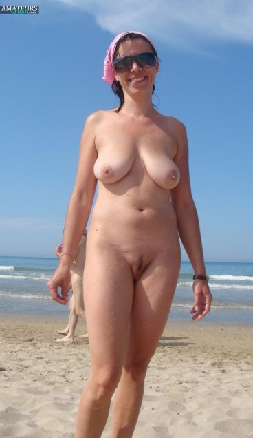 Big boob wife hanging on naked beach