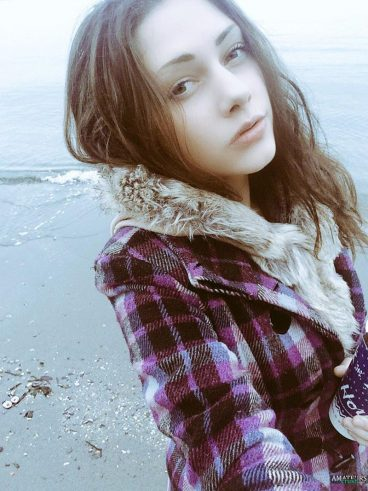 Beach selfie of cambabe Avari in her coat