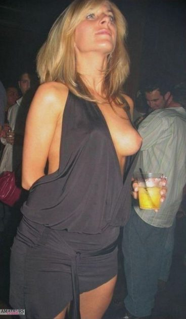 MILF tits exposed in a night club in dress malfunction