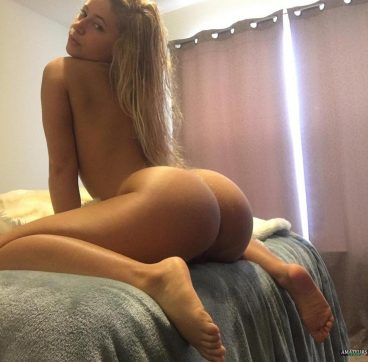 Perfect ass of beautiful blonde amateur girl naked on bed