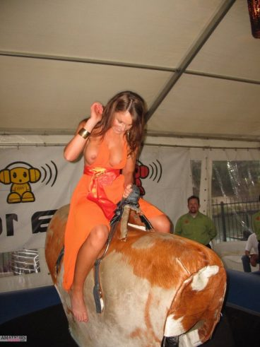 Babe on rough rodeo having dress malfunction and exposing her big boobs oops