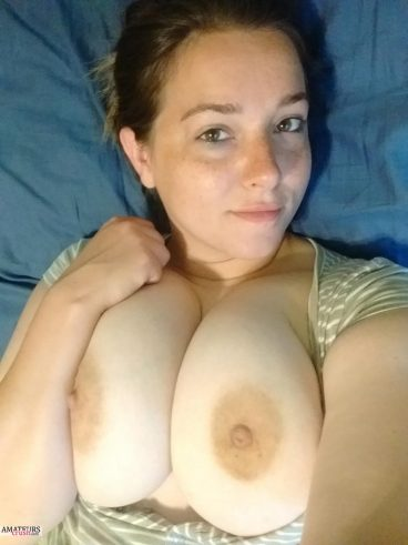 Selfie of soft big boobs amateur girl on bed