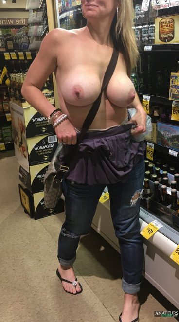 Big boobs milf flashing her tits in store