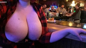 Sexy big tits out in crowded bar