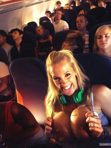 Busty girl flashing her big tits in airplane while people sleeping