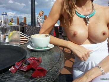 Girlfriend tits flashing on rooftop bar