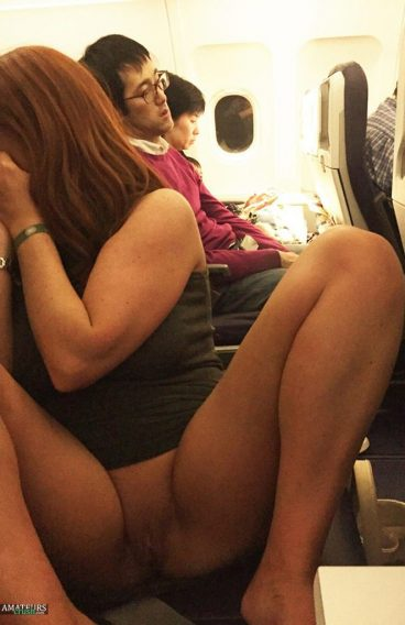 Sexy Asian pussy flashing in public on plane