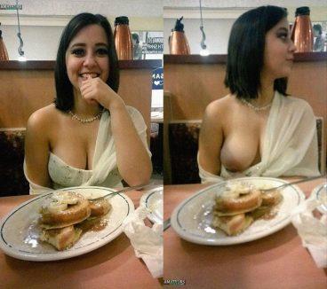 Shy girl flashing boob in public restaurant