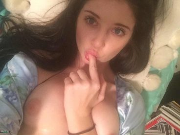 Hot teasing teen in tits selfie on bed
