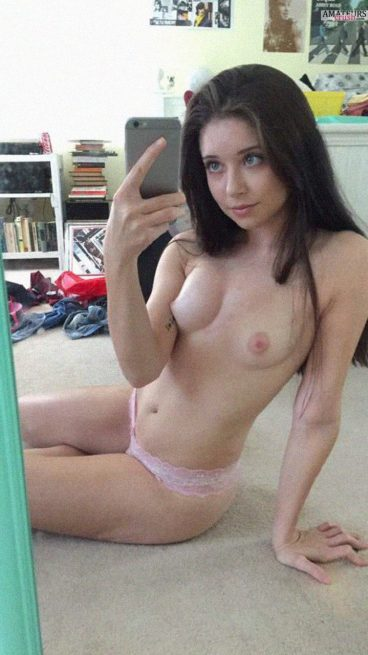 Sexy Ness Chan in pink panties making selfie with her no top on