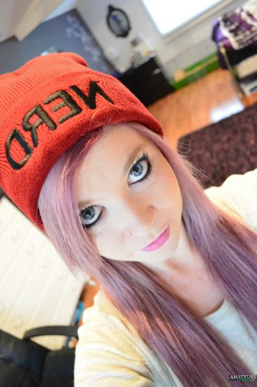 Pink hair ginger girl with cap on selfie picture