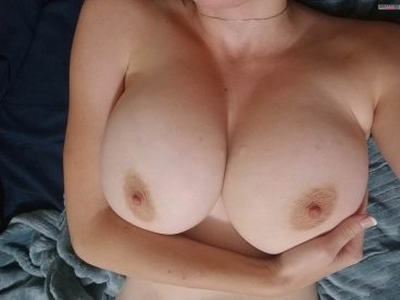 Sexy beautiful busty amateur holding her big tits