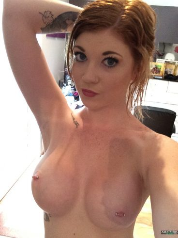 Hot naked ginger girl selfie showing her big tits