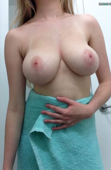 Sexy MILF in towel showing her huge tits