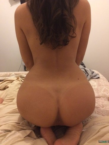 Sexy black nude girlfriend sitting with her naked ass FI