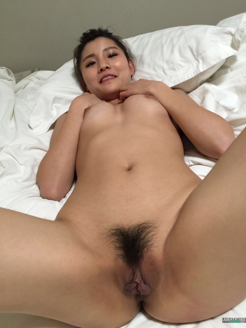 Hot nude Chinese waiting to get fucked on bed with her hairy pussy
