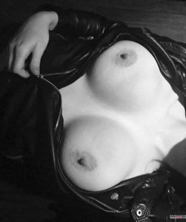 Big tits unzipping leather jacket blackwhite pic