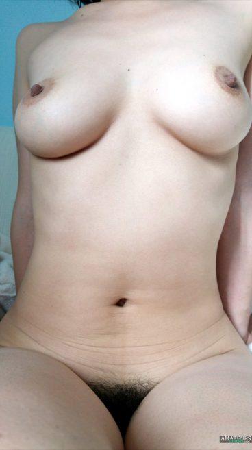 Tasty hard nipples of big tits Asian GF with hairy bush