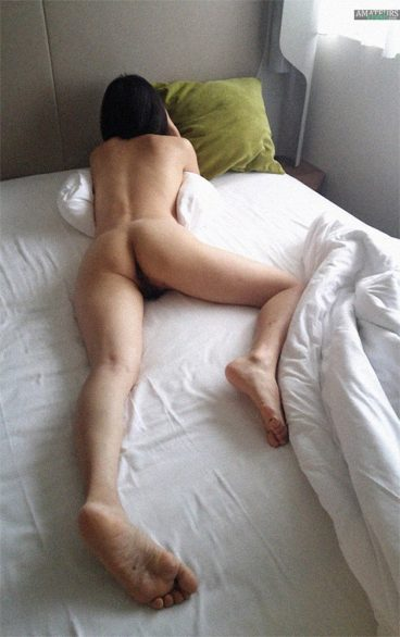 Julia naked on bed showing her nice ass and rear pussy from behind