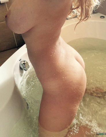 Nice big titted blonde 18+ showing her tight naked ass all wet and dripping