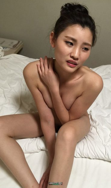 Amazing Chinese nude cutey exposed on bed feeling a bit shy
