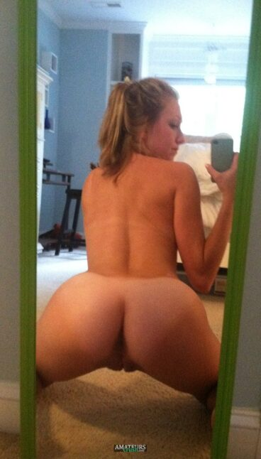 Big naked blonde teen ass bent over from behind selfie
