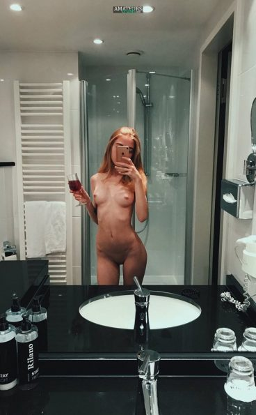 Classy naked girl selfie sipping her wine
