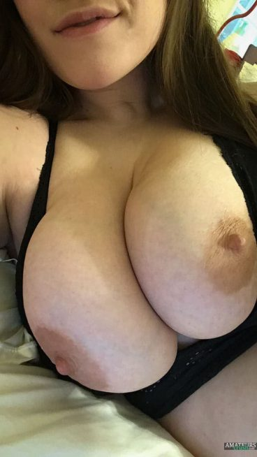 Incredible huge breasts out selfie on bed