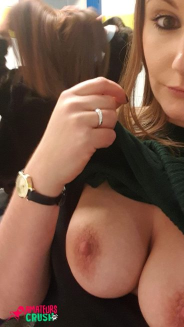 Naughty amateur risky tits out MILF flash pic