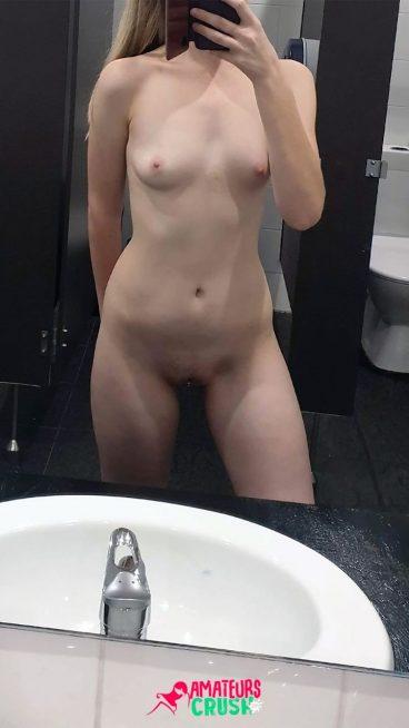 Sexy public bathroom risky nudity selfshot photo